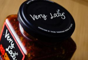 A bottle of cut chilis reading 'Very Lazy'