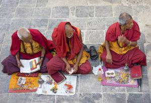 Monks looking in away